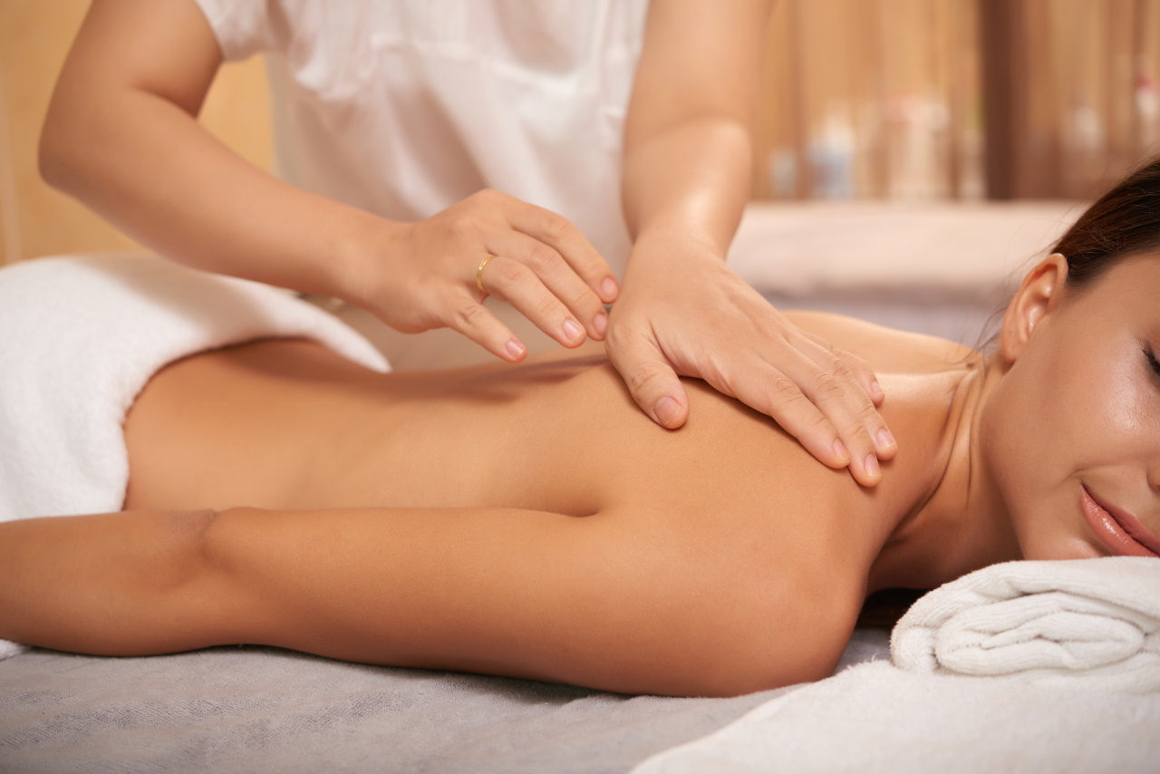 young-woman-getting-back-massage-in-spa-salon